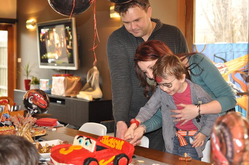 Cutting the Lighting McQueen cake